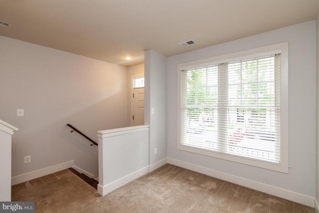 Den on first level by Front door and rear garage - 3102 CHANCELLORS WAY NE, WASHINGTON