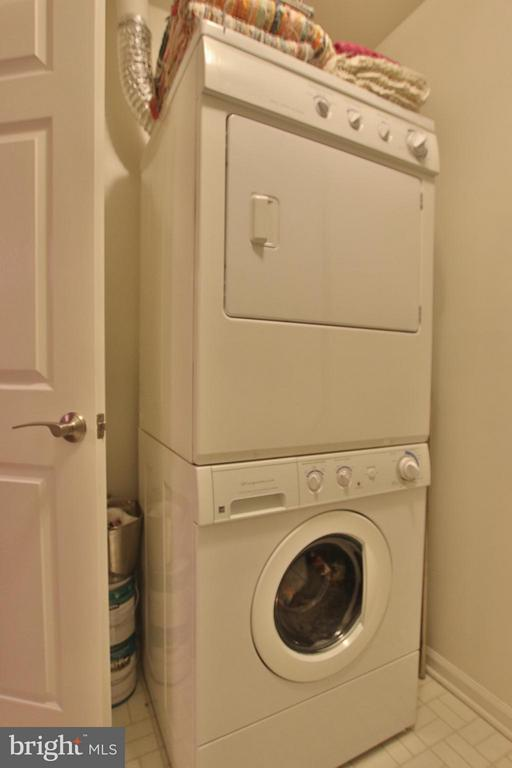Laundry room with stacked washer/dryer - 1435 CHURCH HILL PL #1435, RESTON