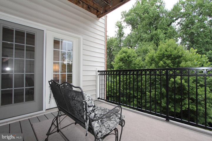 BALCONY OVERLOOKING PRIVATE TREED LOT - 20810 NOBLE TER #208, STERLING