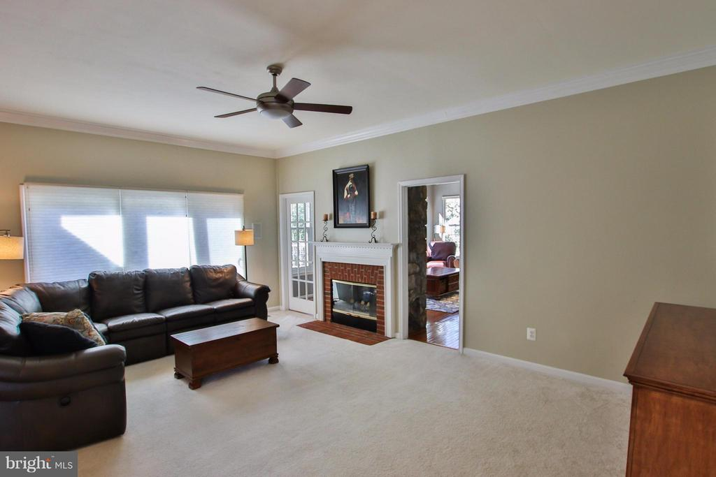 Adjacent family room features dbl sided fpl - 42867 AUTUMN HARVEST CT, BROADLANDS