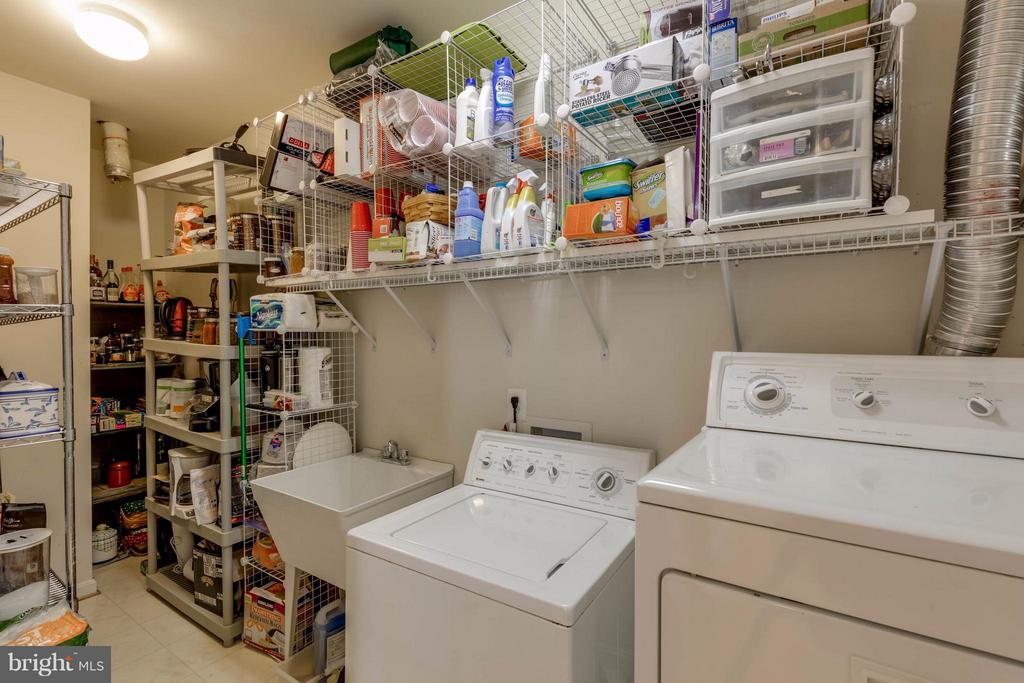 Laundry room and pantry off kitchen - 9745 CRAIGHILL DR, BRISTOW