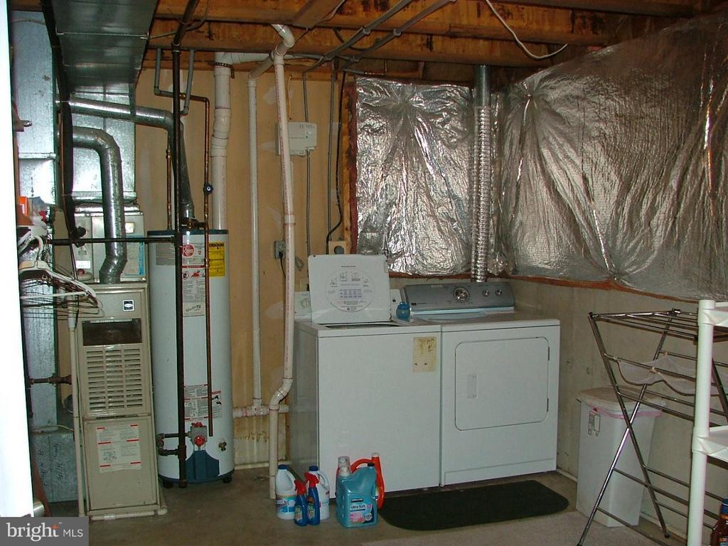 Laundry in Unfinished Basement - 843 SMARTTS LN NE, LEESBURG