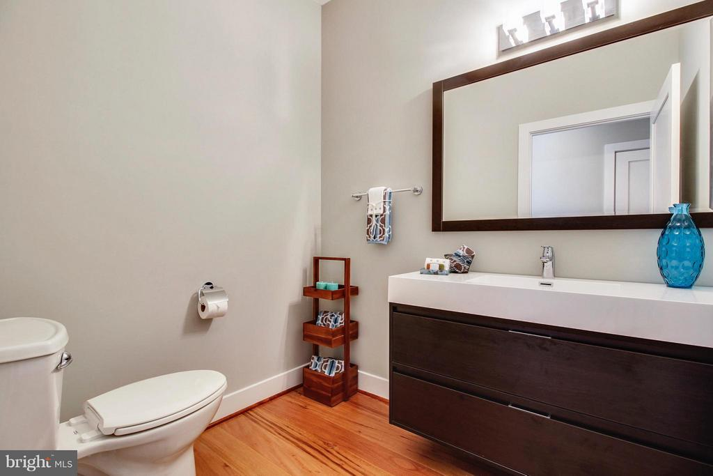 Powder room with floating vanity - 4415 BILL MOXLEY, MOUNT AIRY