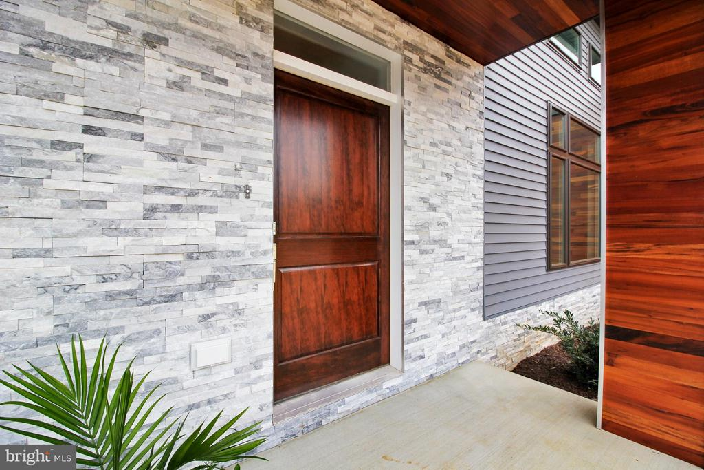 Portico features Tigerwood and natural stone - 4415 BILL MOXLEY, MOUNT AIRY
