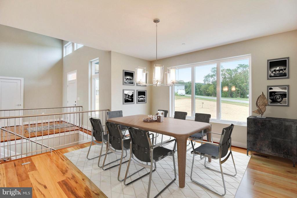 This dining area accommodates a massive table - 4415 BILL MOXLEY, MOUNT AIRY