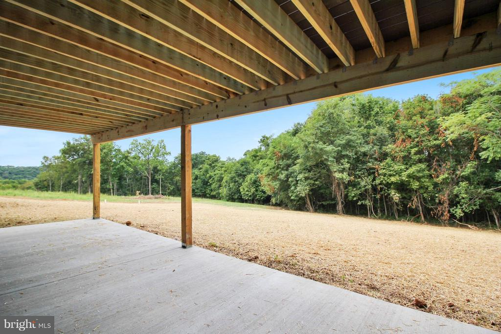 The patio below leads to gently sloping yard - 4415 BILL MOXLEY, MOUNT AIRY