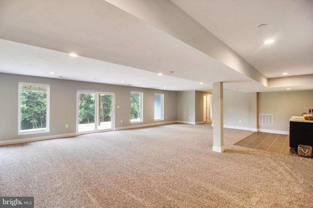 Large, light-filled recreation area in basement - 4415 BILL MOXLEY, MOUNT AIRY