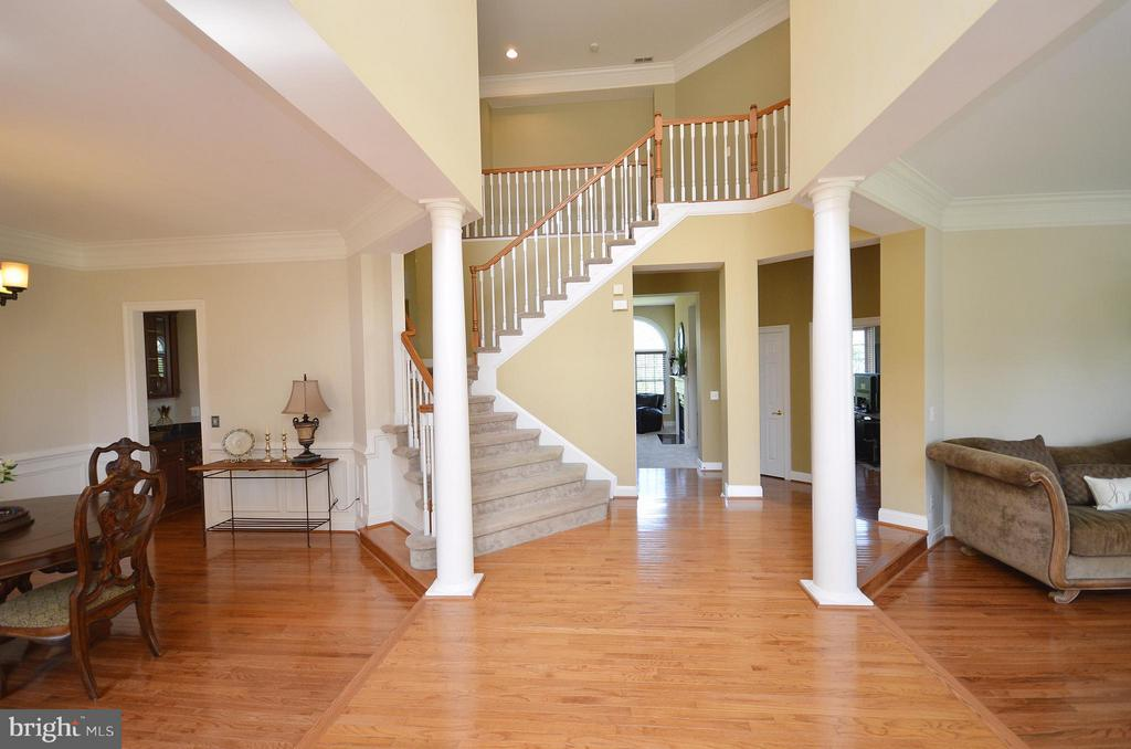 Large Foyer Entrance with dual staircase - 42828 FOREST SPRING DR, LEESBURG