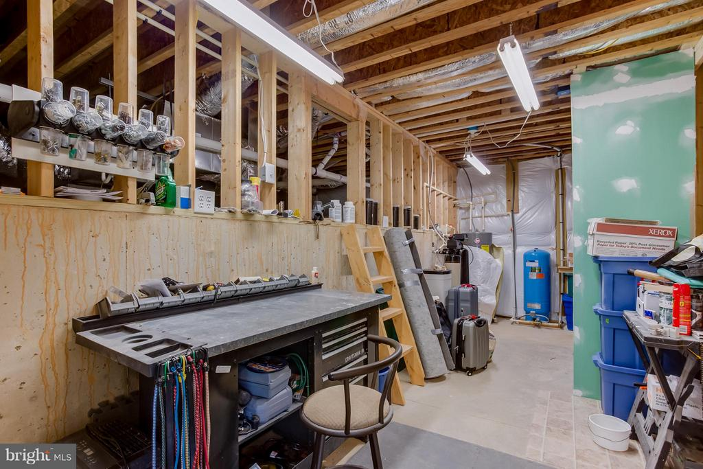 Basement storage and work area - 7929 DOWD FARM RD, SPOTSYLVANIA
