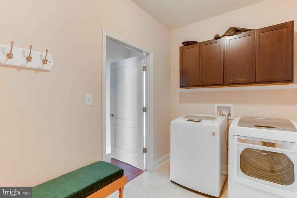 Laundry room leads to garage and basement - 7929 DOWD FARM RD, SPOTSYLVANIA