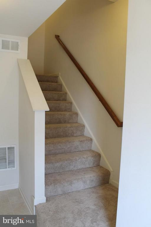 Stairways going to Main Level - 117 MONTICELLO SQ, WINCHESTER