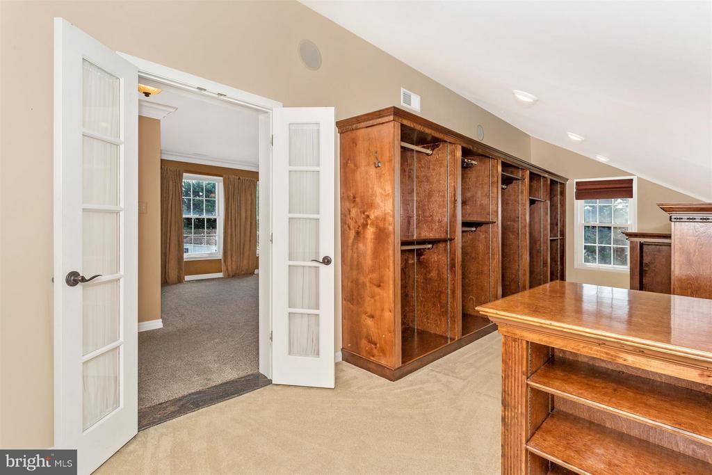 Walk in closet with custom built ins. - 2301 FARMERS CT, ADAMSTOWN
