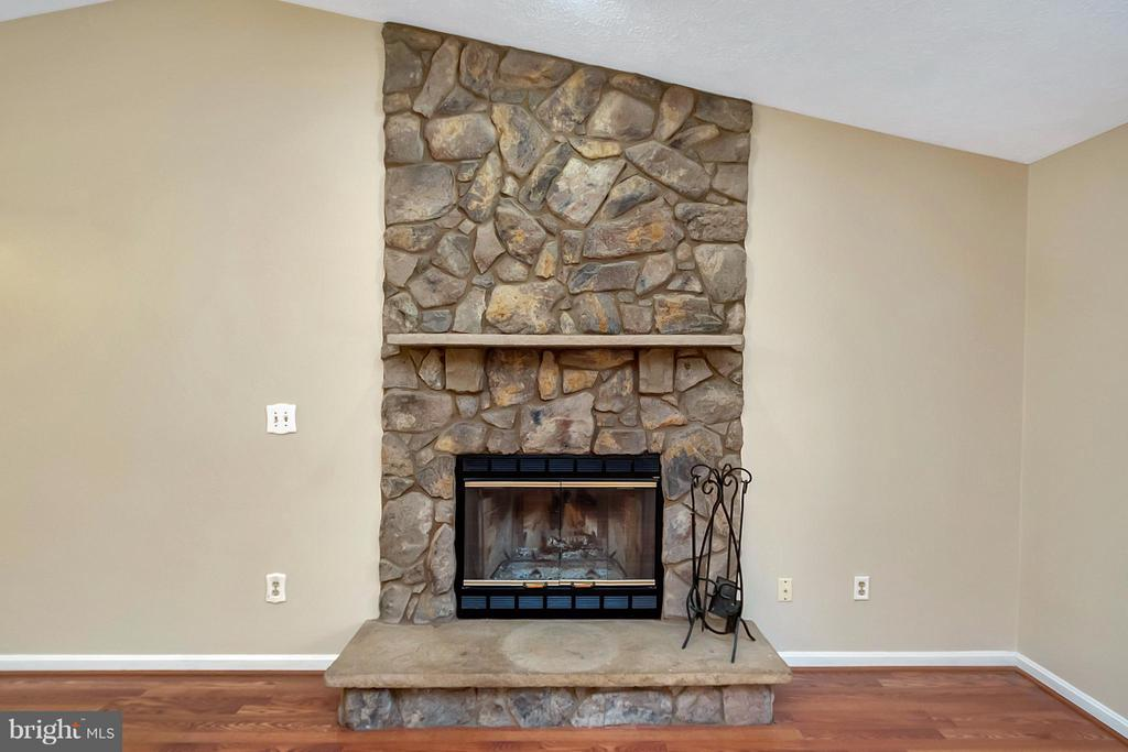 Living Room Stone Fireplace - 11906 HUNTING RIDGE DR, FREDERICKSBURG