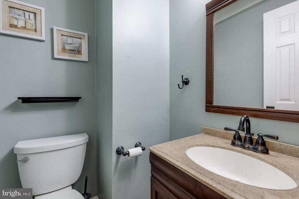 Powder room by front door and kitchen - 11841 DUNLOP CT, RESTON