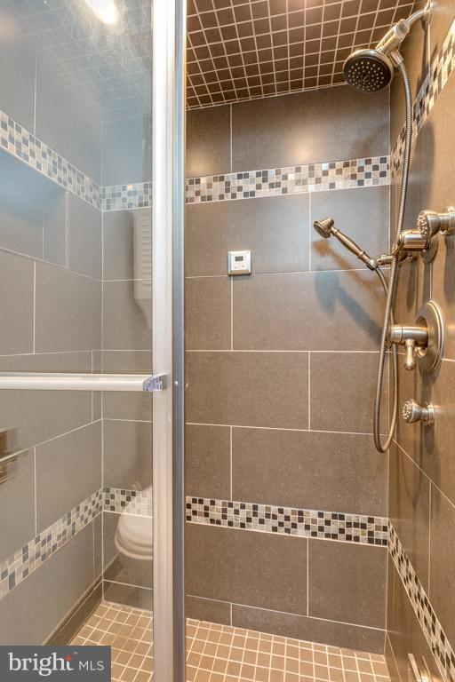 Master bath with gorgeous tilework - 292 M ST SW #292, WASHINGTON