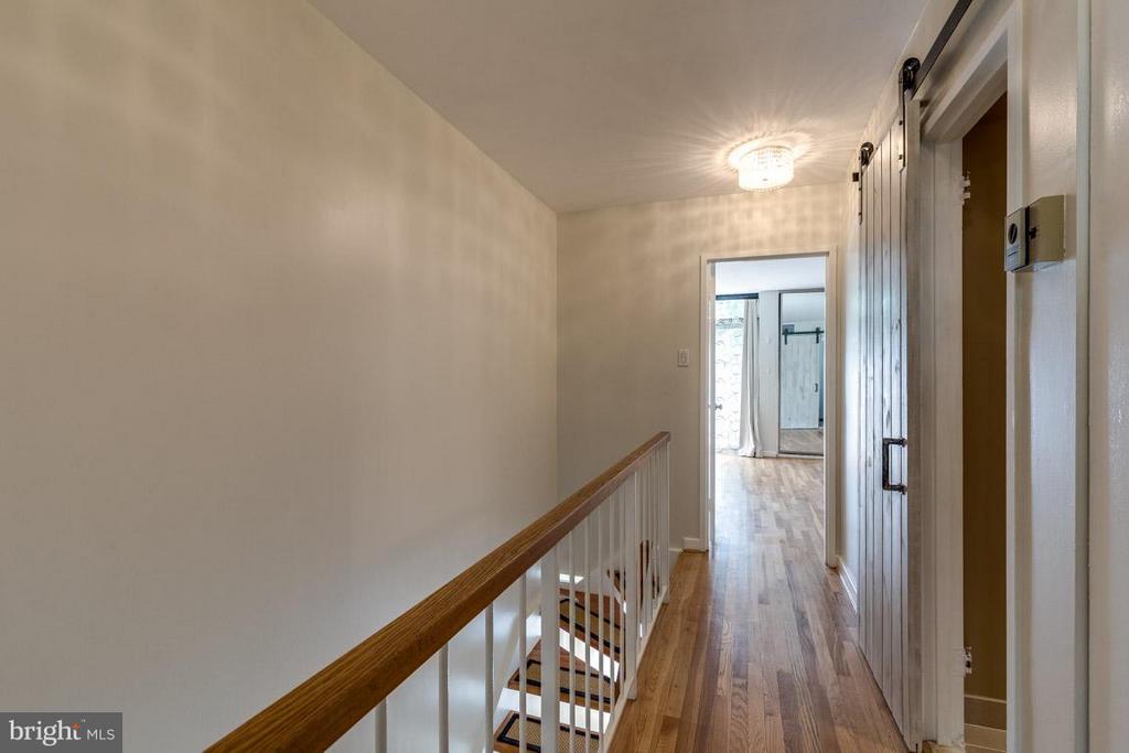 Upstairs hallway w/ barn doors to second bath - 292 M ST SW #292, WASHINGTON