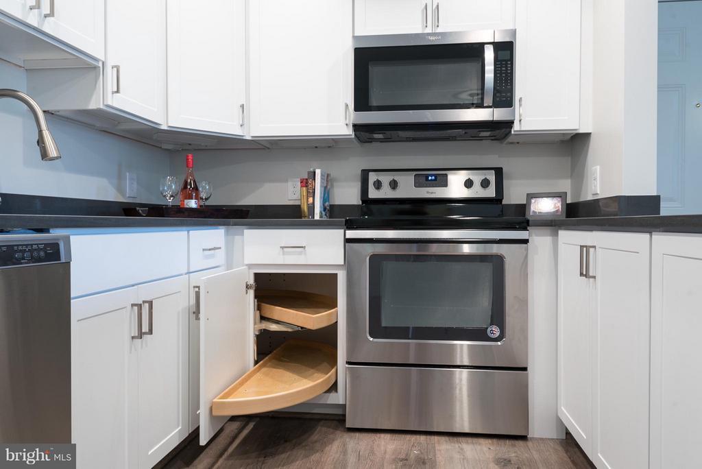 Kitchen- oversized lazy susan to maximize storage! - 10721 HAMPTON MILL TER #212, ROCKVILLE