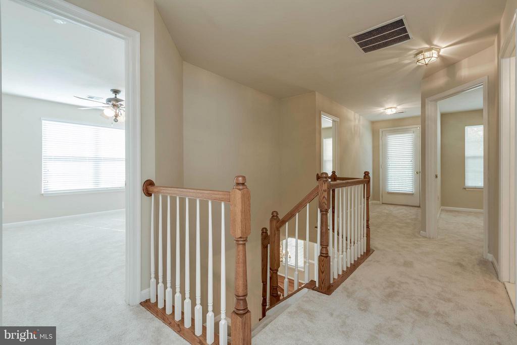 Upstairs Hallway leading to Exterior Porch - 9340 SUMNER LAKE BLVD, MANASSAS