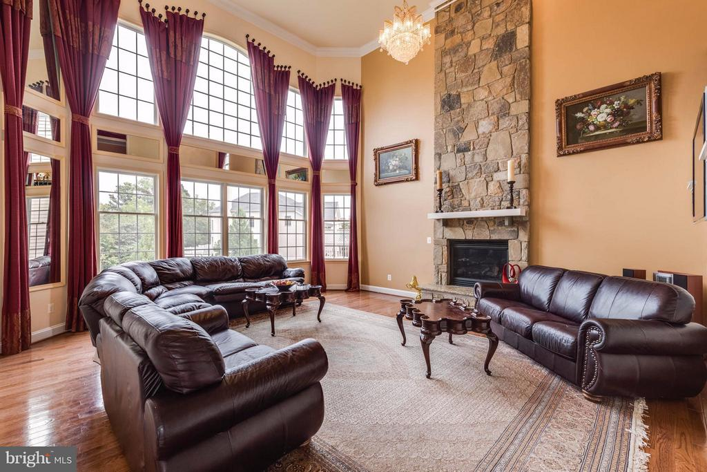 Light filled two story family room-stone fireplace - 22728 DULLES GAP CT, ASHBURN