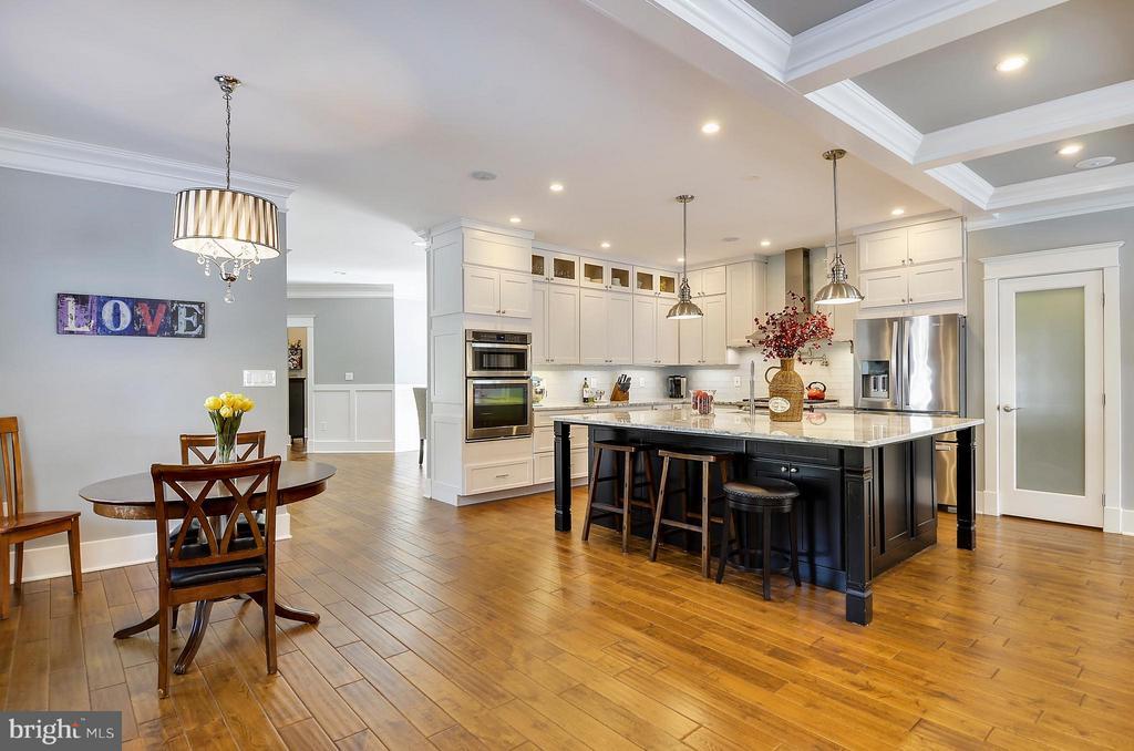 Chef's kitchen has massive marble island - 5656 5TH ST N, ARLINGTON