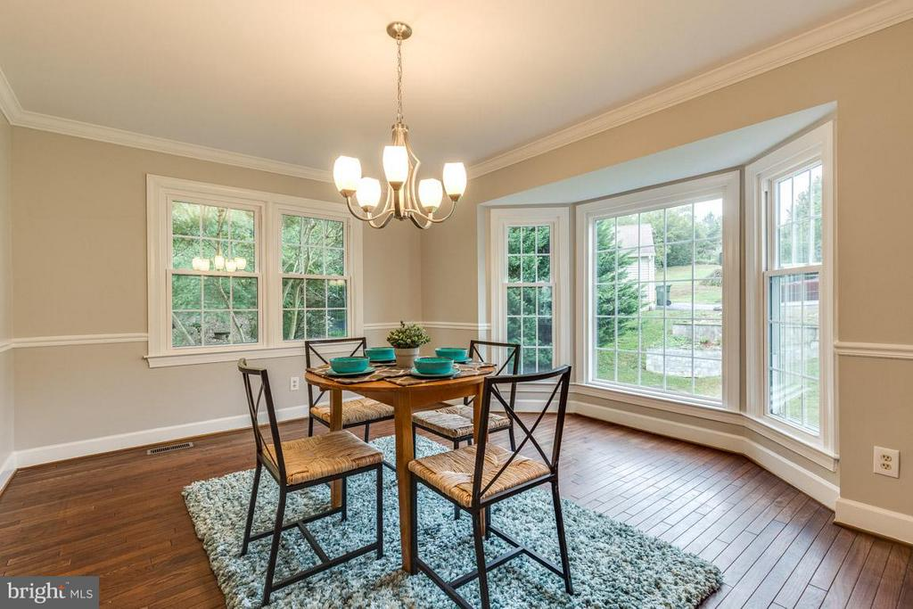 Light pours through the bay window. - 12105 METCALF CIR, FAIRFAX