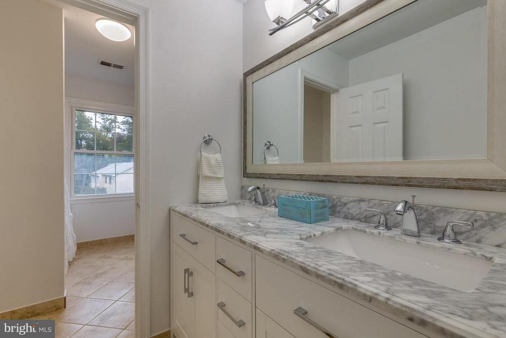 Remodeled 2nd bathroom with carrera marble vanity. - 12105 METCALF CIR, FAIRFAX