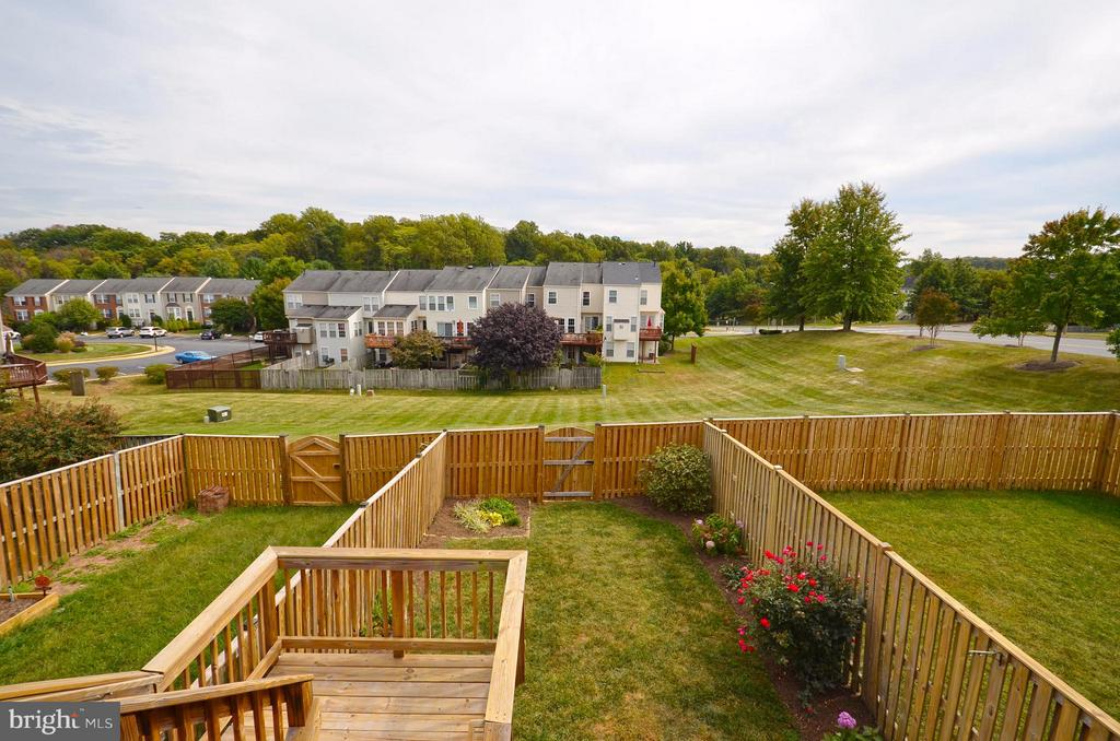 Deck View backing to Large Common Space - 204 SHIRLEY SQ SE, LEESBURG