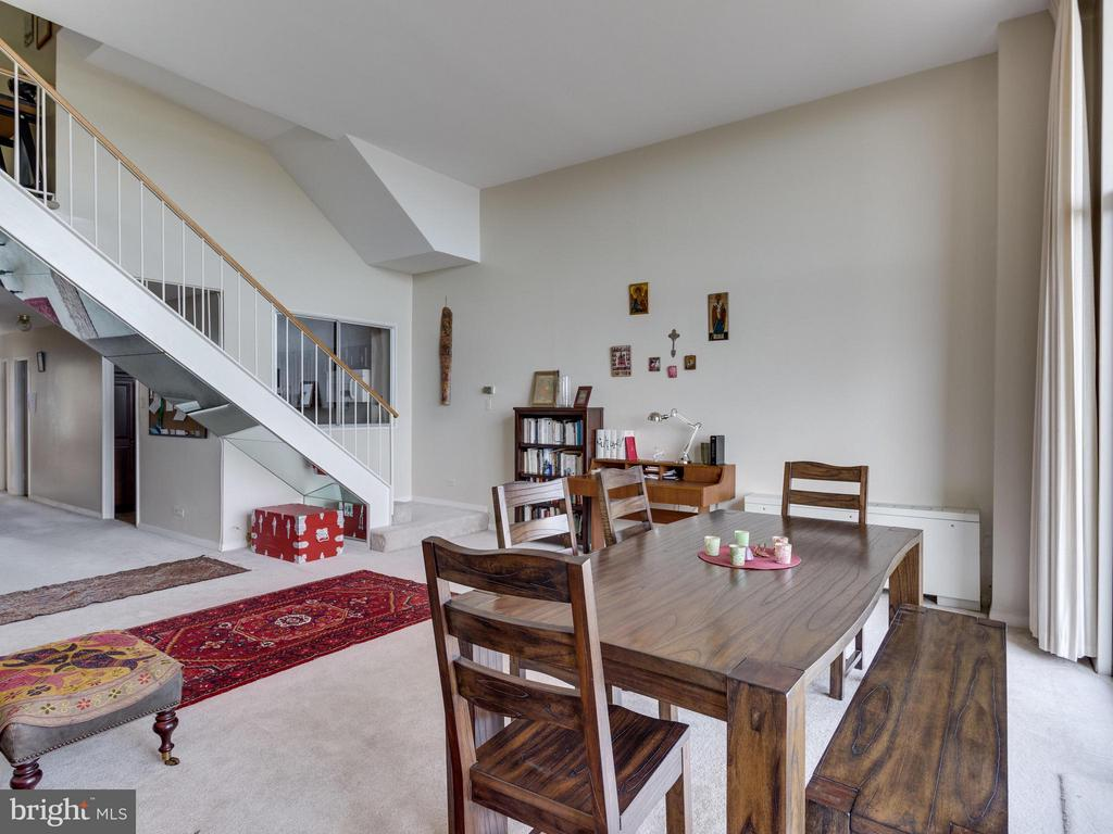LR w/stairway from upper foyer - 1200 NASH ST #857, ARLINGTON