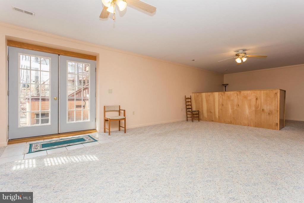 Family Room Patio Door walks out to patio - 203 BEACHSIDE CV, LOCUST GROVE