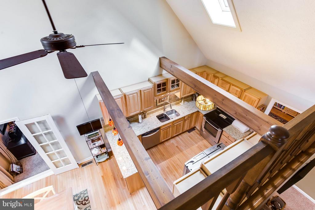 Loft overlook into kitchen - 103 CREEKSIDE DR, LOCUST GROVE