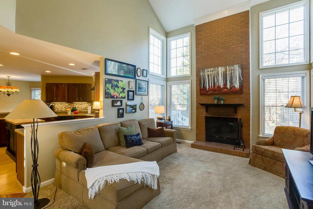 Family Room is open two story w/ wood fireplace - 6 APPLING RD, STAFFORD