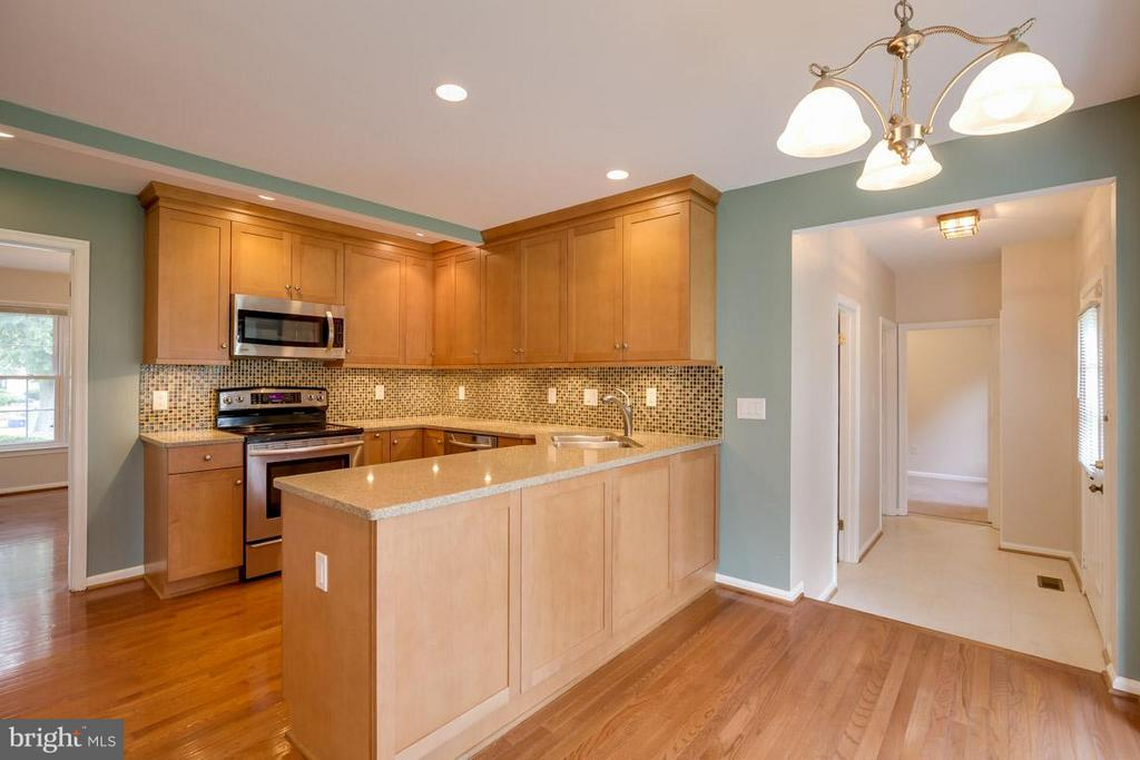 New Hardwood flooring in the kitchn - 13609 DAIRY LOU CT, OAK HILL