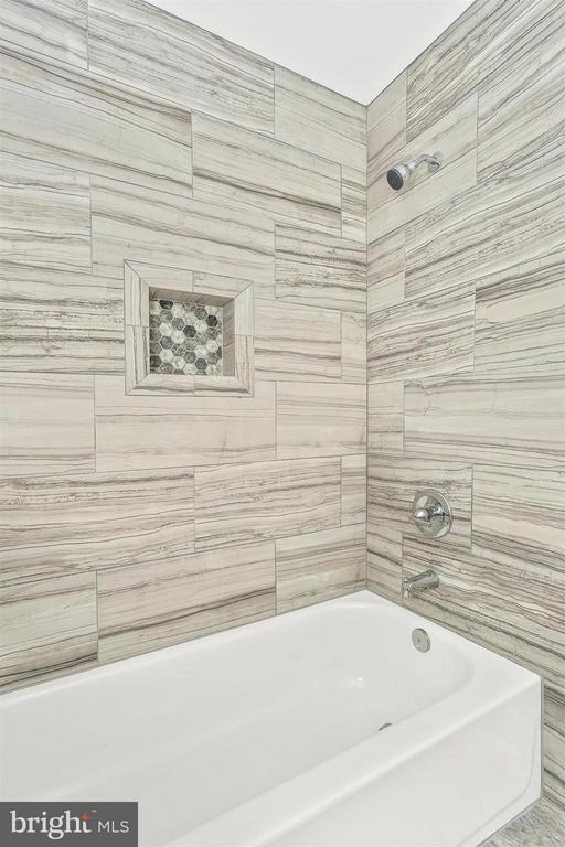 Upper level bathroom. Designer porcelain tile. - 8 TANEY CT, TANEYTOWN