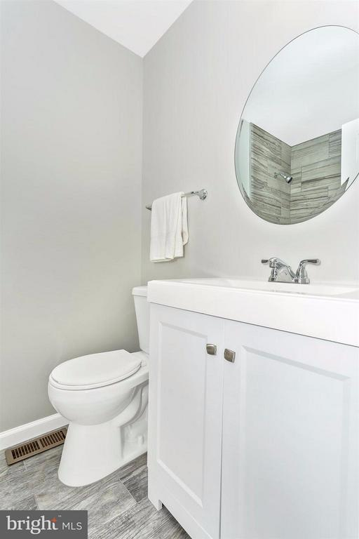 Upper level bathroom. New tub, toilet and vanity. - 8 TANEY CT, TANEYTOWN