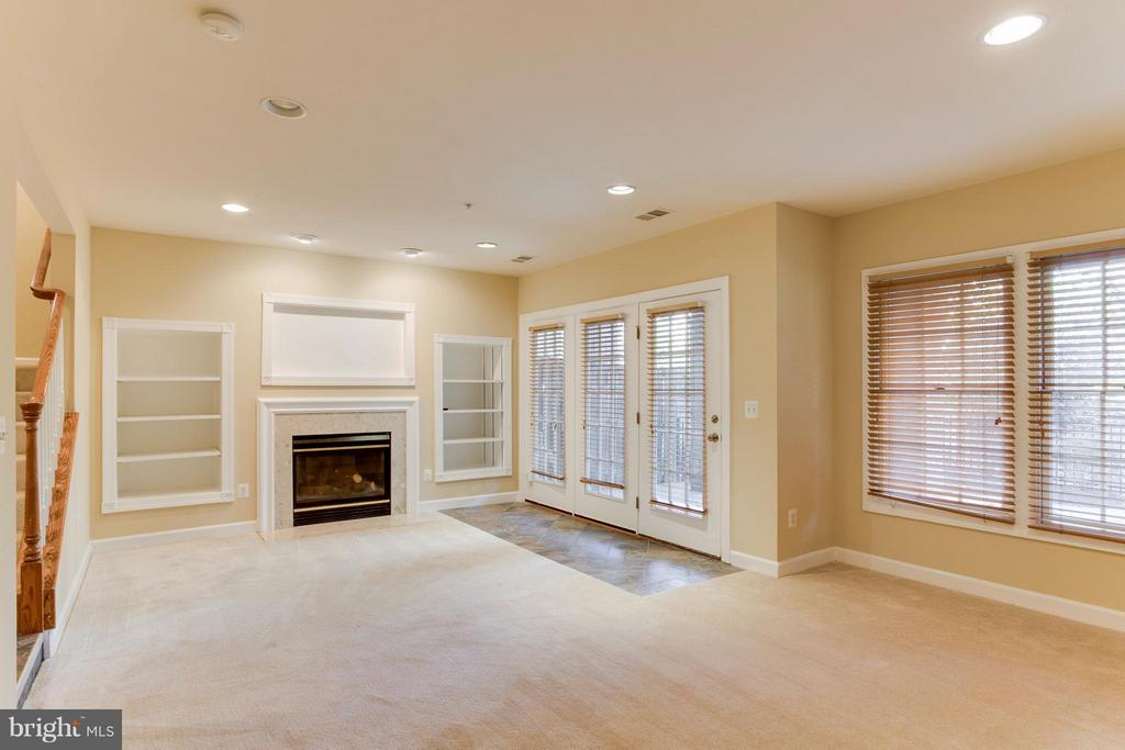 Sitting area by the fireplace flows to the patio - 18530 BEAR CREEK TER, LEESBURG