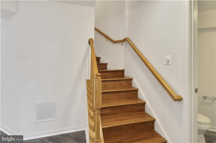 Hard wood staircase all top to bottom of house. - 5507 WESTCOTT CIR, FREDERICK