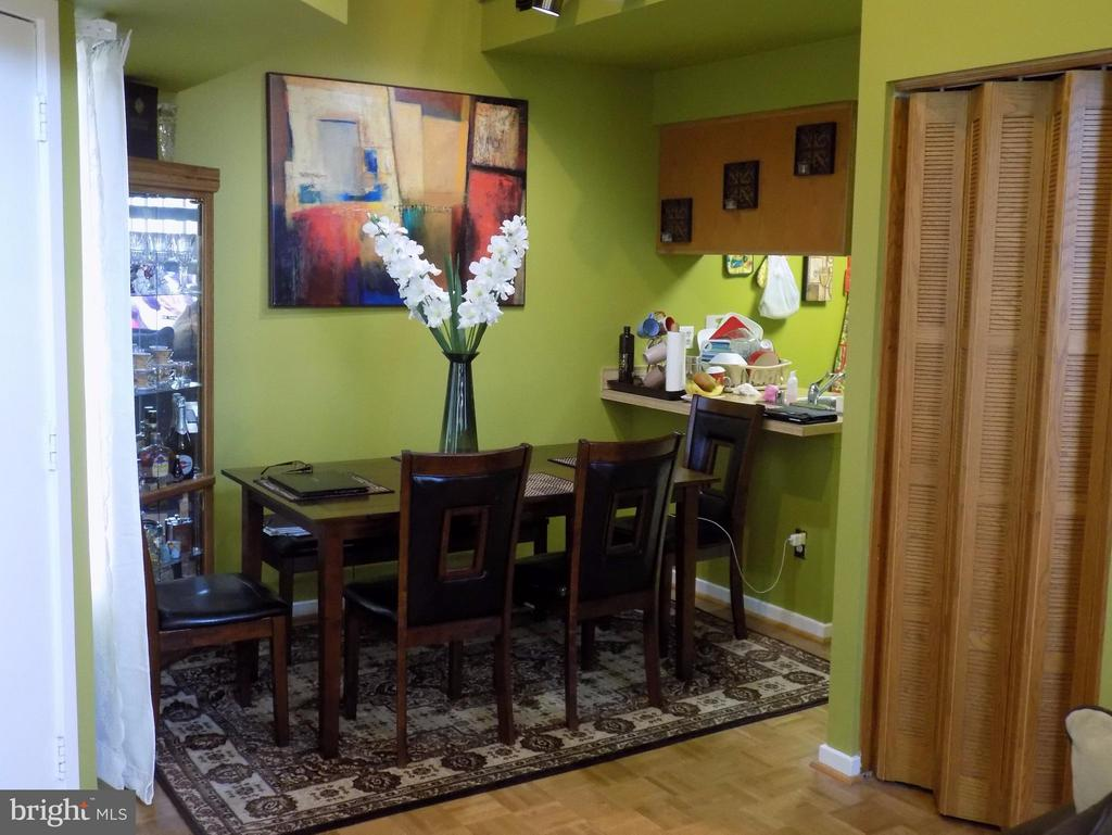 Dining Room view from Living room! Soups on!! - 18432 BISHOPSTONE CT #306, GAITHERSBURG