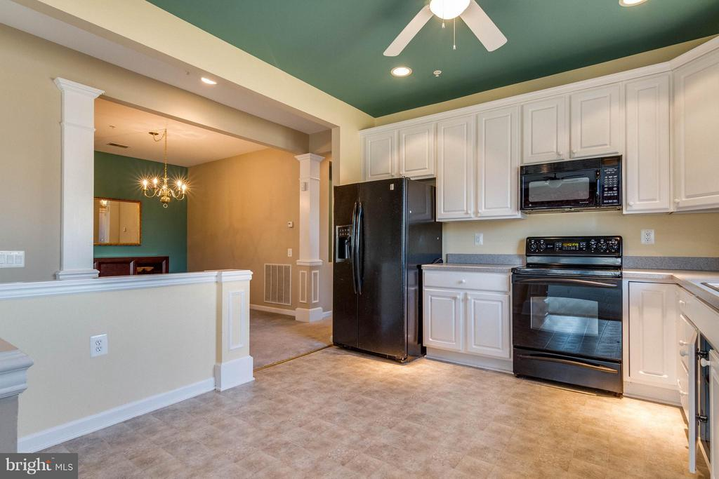 Kitchen features ceiling fan and recessed lights - 1 ASPEN HILL DR #50, FREDERICKSBURG
