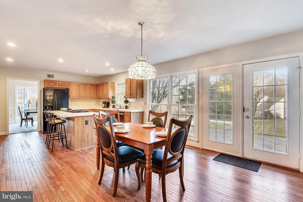 Kitchen dining space. French doors to deck - 22520 SWEETLEAF LN, GAITHERSBURG