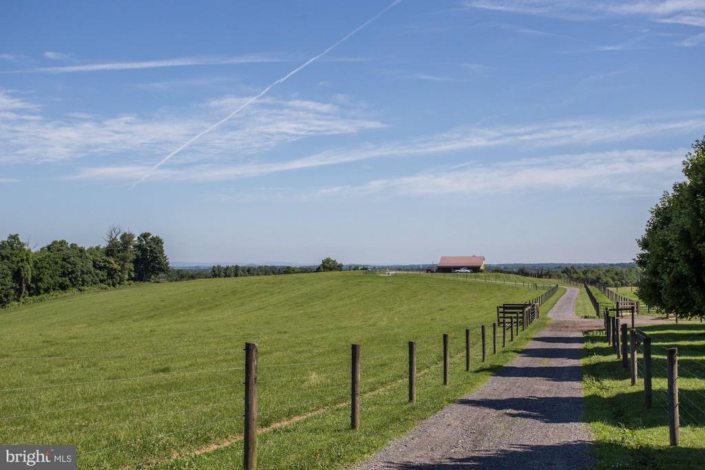 Beautiful rolling hills extend across the property - 11606 HANDBOARD RD, UNION BRIDGE