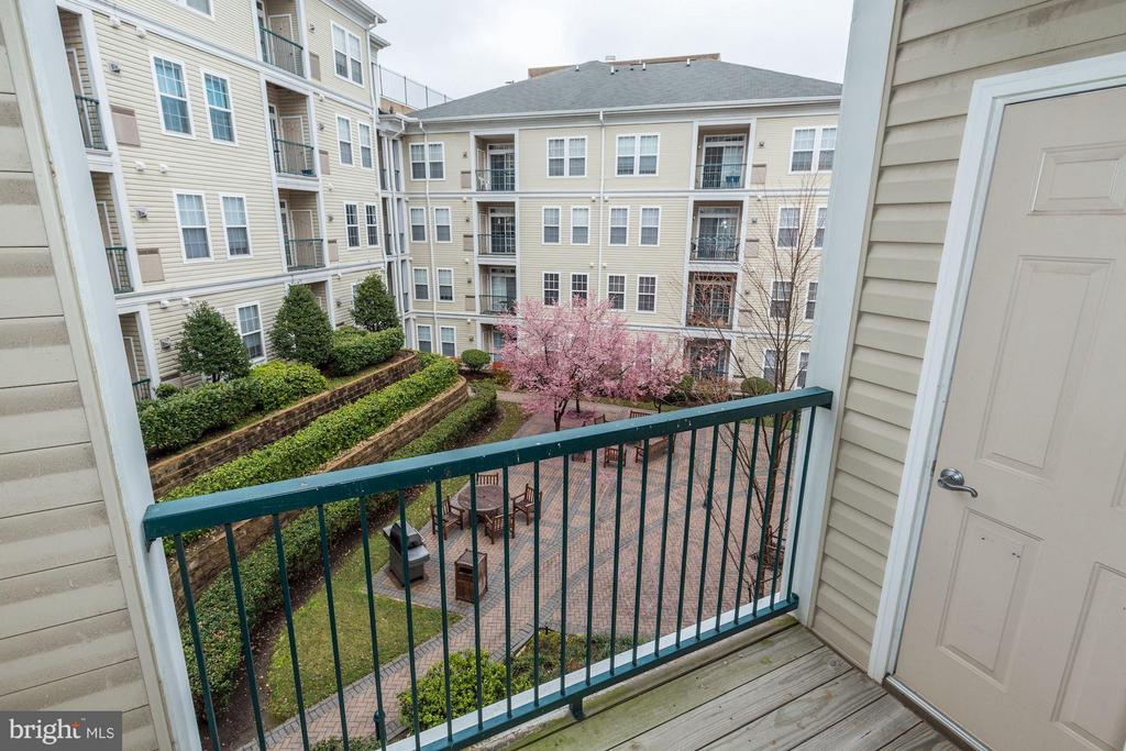 BEAUTIFUL VIEW OF COURTYARD BELOW FROM BALCONY! - 2465 ARMY NAVY DR #1-210, ARLINGTON