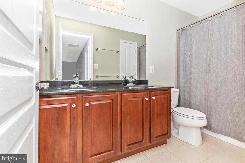 Upper level half full  bath. - 6327 MEANDERING WOODS CT, FREDERICK