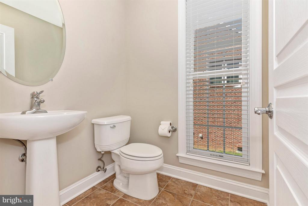 Main level powder room. - 6327 MEANDERING WOODS CT, FREDERICK