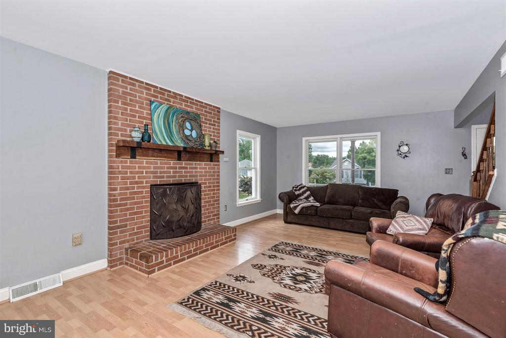 Living Room with Brick Fireplace and Sliding doors - 106 FOUNDERS CIR, THURMONT