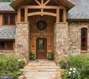 Majestic front entrance of stone and timber - 8922 JEFFERY RD, GREAT FALLS