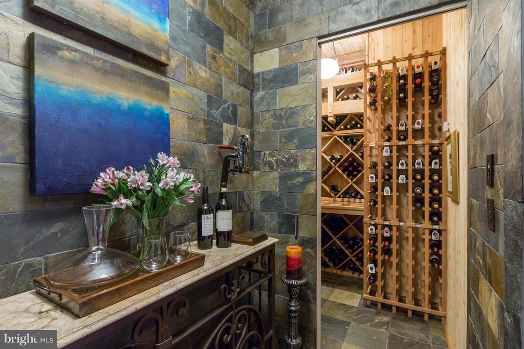 Slate vestibule with hidden wine cellar - 8922 JEFFERY RD, GREAT FALLS
