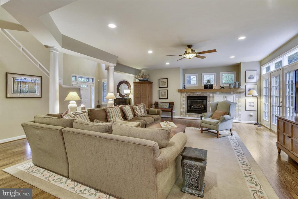 Family Room with Gas Fireplace with exit to deck - 1338 RED HAWK CIR, RESTON