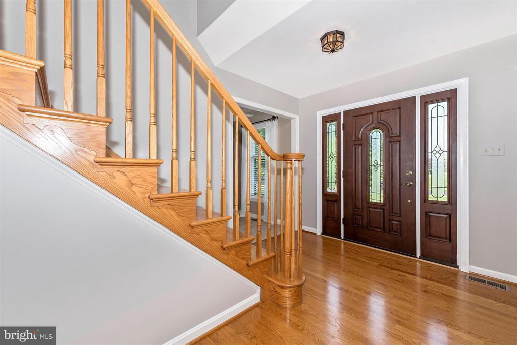 foyer with grand staircase - 4800 MARIANNE DR, MOUNT AIRY