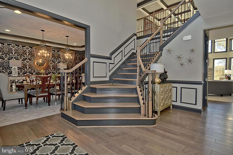 DRAMATIC CURVED STAIRWAY - 14270 BURNTWOODS RD, GLENWOOD