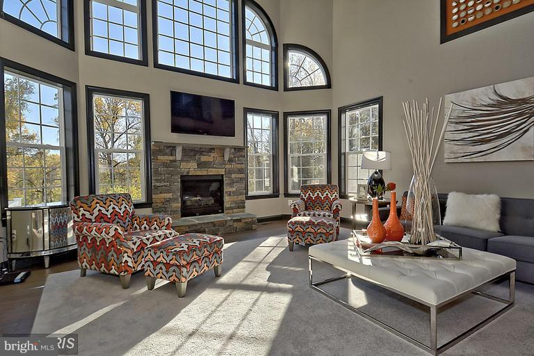 TWO STORY FAMILY ROOM FILLED WITH NATURAL LIGHT - 14270 BURNTWOODS RD, GLENWOOD